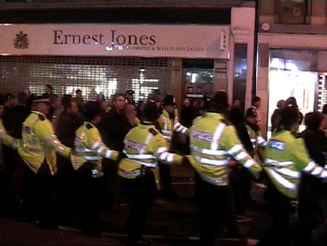 heavy cordon escorts protestors along oxford street