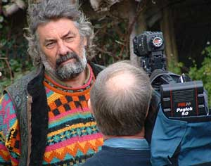 Tony Wrench interviewed for TV outside his now occupied house.